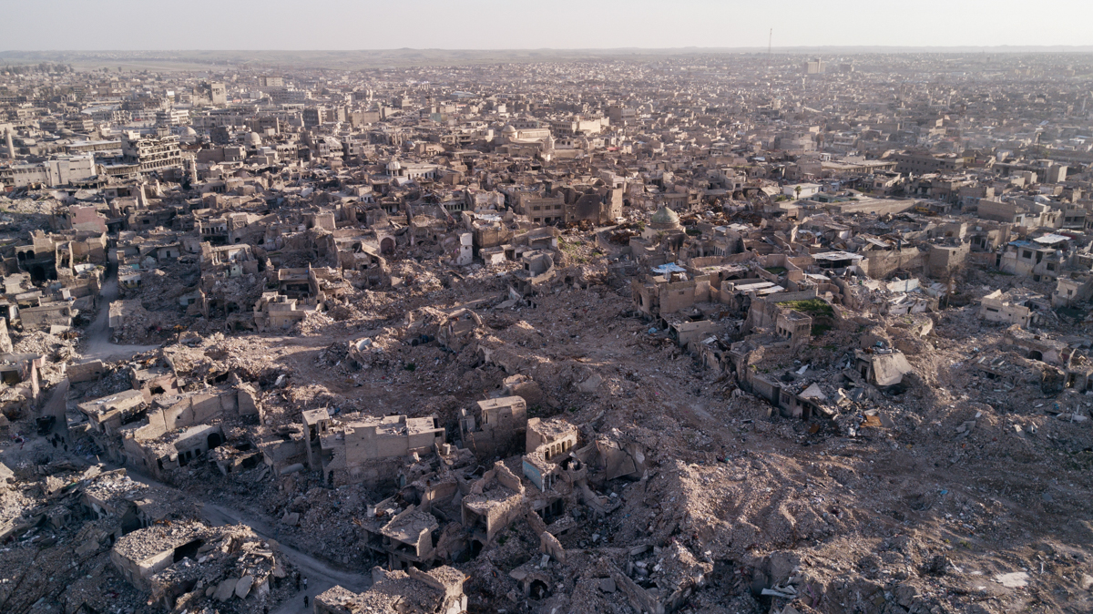 Aerial view of Mosul's old city. The area was heavily bombarded by the US-led coalition and left nearly all buildings destroyed. Colonel Rabie Ibrahim Hassan, 47, chief of Mosul's civil defence estimates that there could be some 5,000 bodies still scattered throughout the city and the reconstruction process might take years. [Felipe Paiva/Al Jazeera]