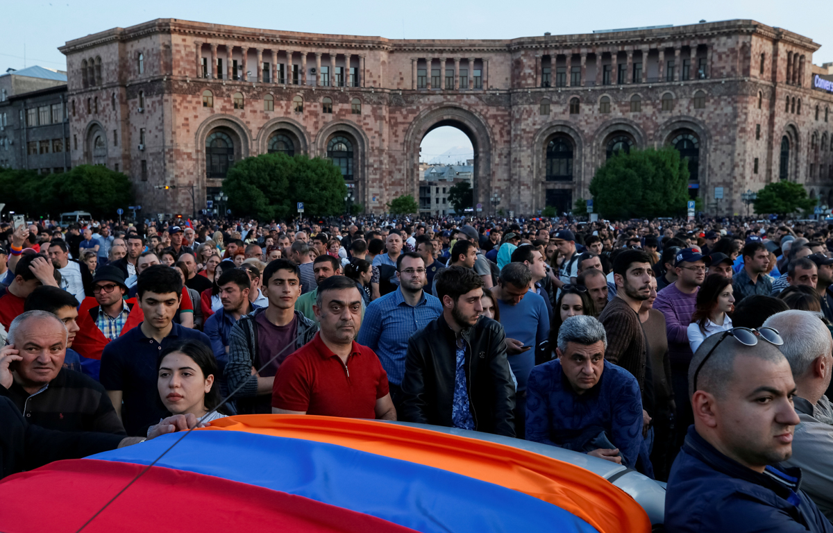 Supporters of Armenian opposition leader Nikol Pashinyan attend a rally against the ruling elite in Yerevan, Armenia. [Gleb Garanich/Reuters]