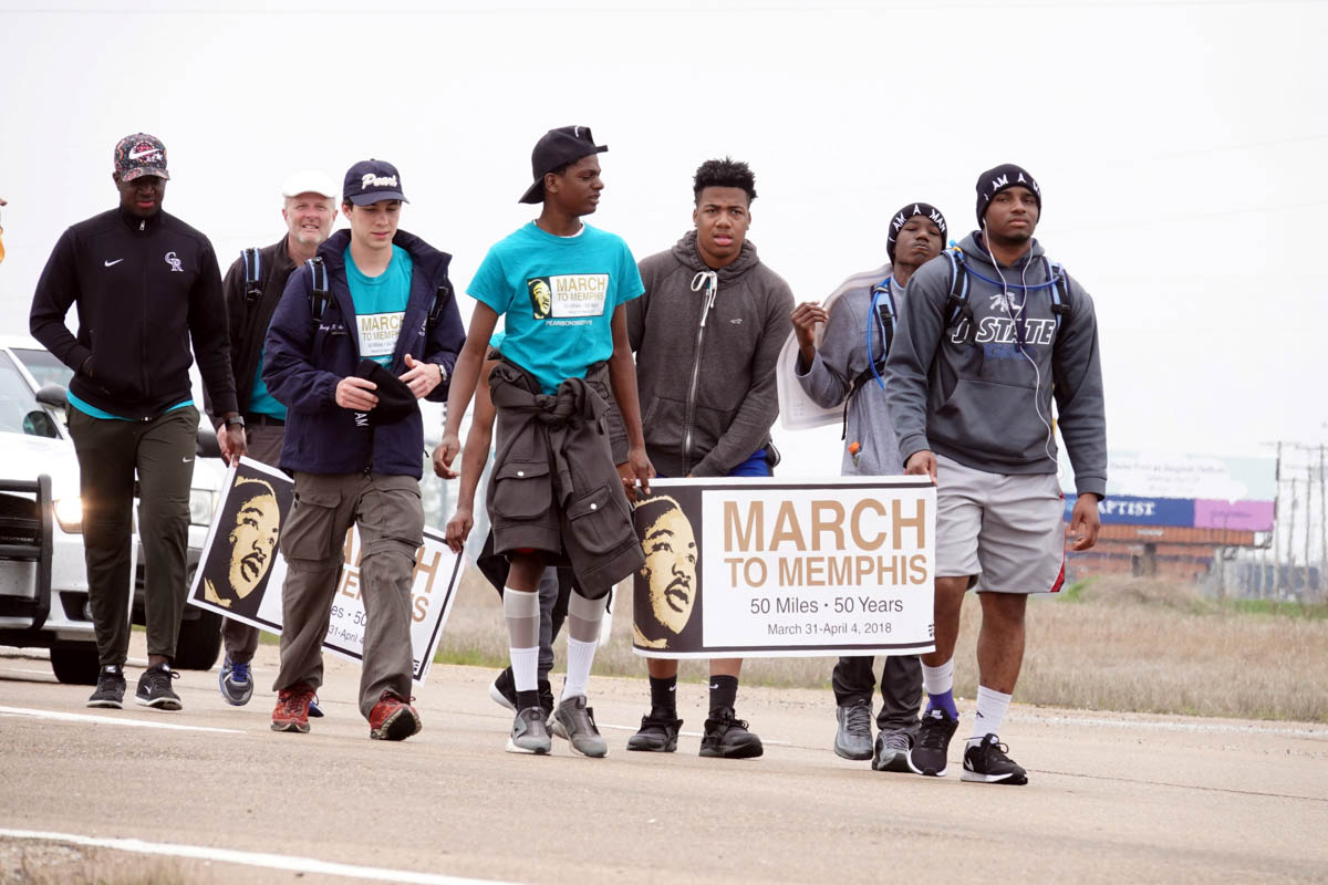 A group of teenagers from Pearl, Mississippi, walk along US highway 61 just south of Memphis, on their 50-mile 'March to Memphis' tribute to Martin Luther King Jr. [Karen Pulfer Focht/Reuters]