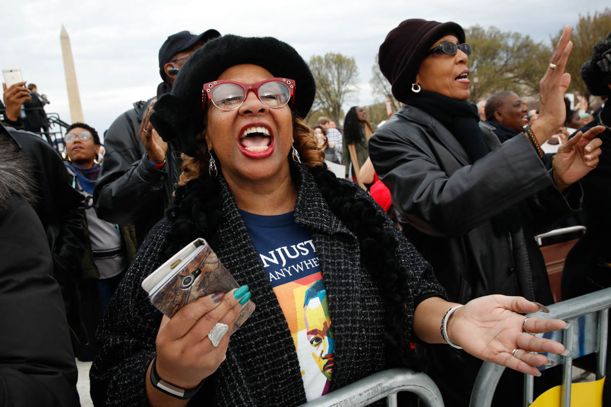 Debra Payne, of Kansas City, Missouri, sings 'This Little Light of Mine' next to Jo-Lynn Gilliam, of East Point, Georgia, as they attend the ACT To End Racism rally on the National Mall in Washington, DC, on the 50th anniversary of Martin Luther King, Jr's assassination. [Jacquelyn Martin/AP Photo]
