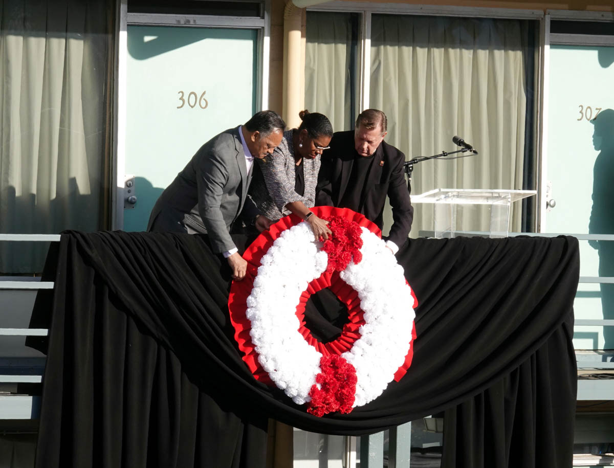 Reverend Jessie Jackson, left, places a wreath on the balcony at the Lorraine Hotel, now the National Civil Right Museum in Memphis, Tennessee, US. [Karen Pulfer Focht/Reuters]