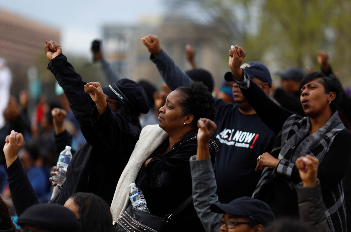 People attend a silent march on the National Mall to mark the 50th anniversary of the assassination of civil rights leader Rev. Martin Luther King Jr in Washington, DC. [Eric Thayer/Reuters]