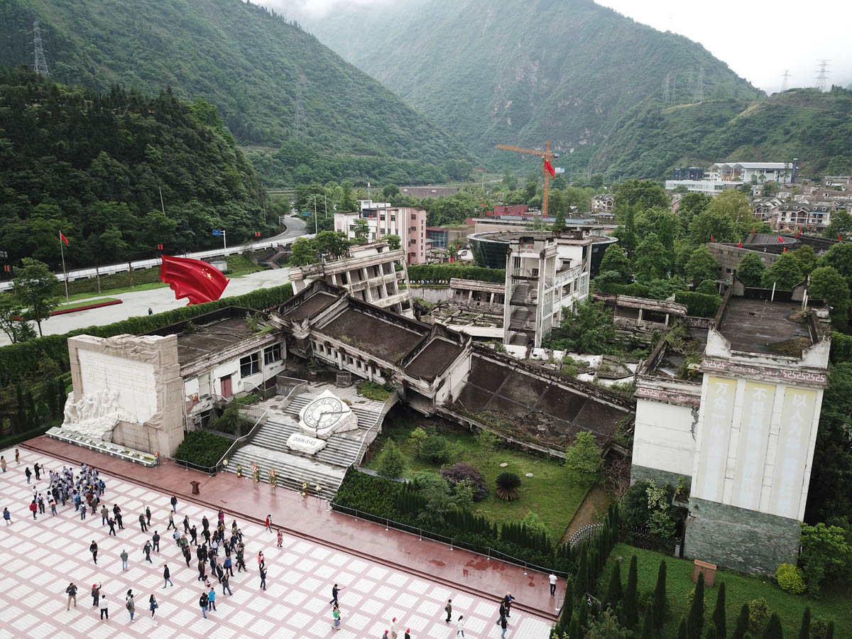 Xingxiu town was the epicentre of the devastating 2008 earthquake. Almost all its buildings were destroyed, including the town's middle school. Xingxiu has been rebuilt, but the rubble of the school has been preserved as part of an official memorial site. [Peng Peng/Al Jazeera]