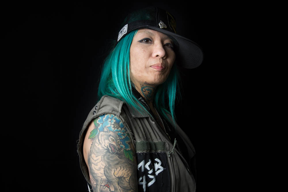 Asami Kouzma, 35, who works in the music industry, got her first tattoo 20 years ago. While she likes her tattoos, she says they can make it difficult to find work. Asami has a 'Wabori' – a traditional Japanese tattoo - depicting wolves, who are said to mate for life. Her tattoos are often a topic of conversation when she meets new people, she says. [Yuichi Yamazaki/Al Jazeera]