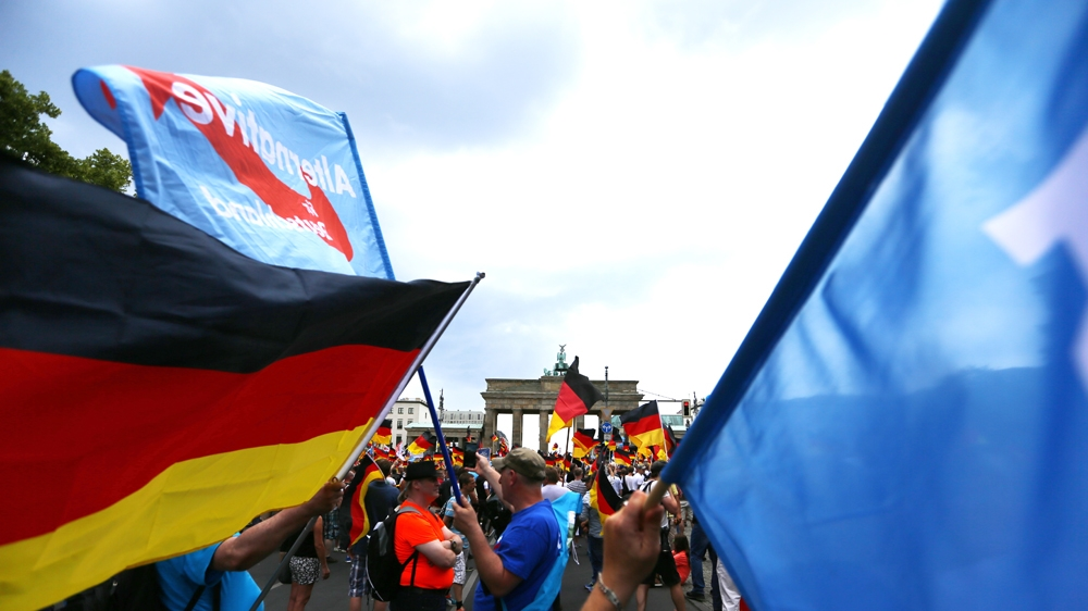 Supporters of the Anti-immigration party Alternative for Germany (AfD) attend a protest in Berlin, Germany May 27, 2018. [Hannibal Hanschke/Reuters]