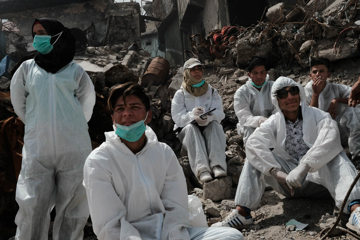 Initially, four friends started to collect the dead bodies in October 2017. The Civil Defense Corps of Iraq stopped their work in January 2018 because they said there were no further civilians beneath the rubble and they refused to collect the dead bodies of ISIL fighters. [Vincent Haiges/Al Jazeera]