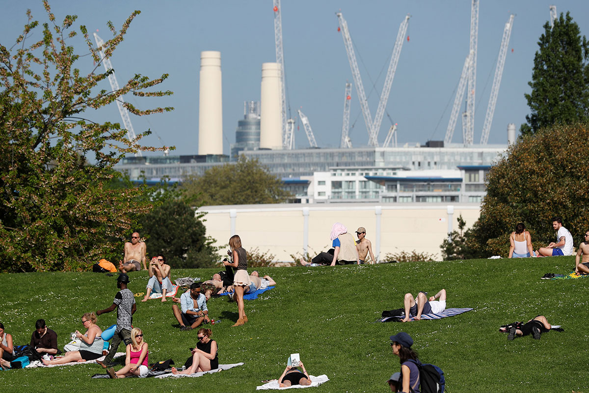 Blue skies in London tempts locals to the parks. [Peter Nicholls/Reuters]