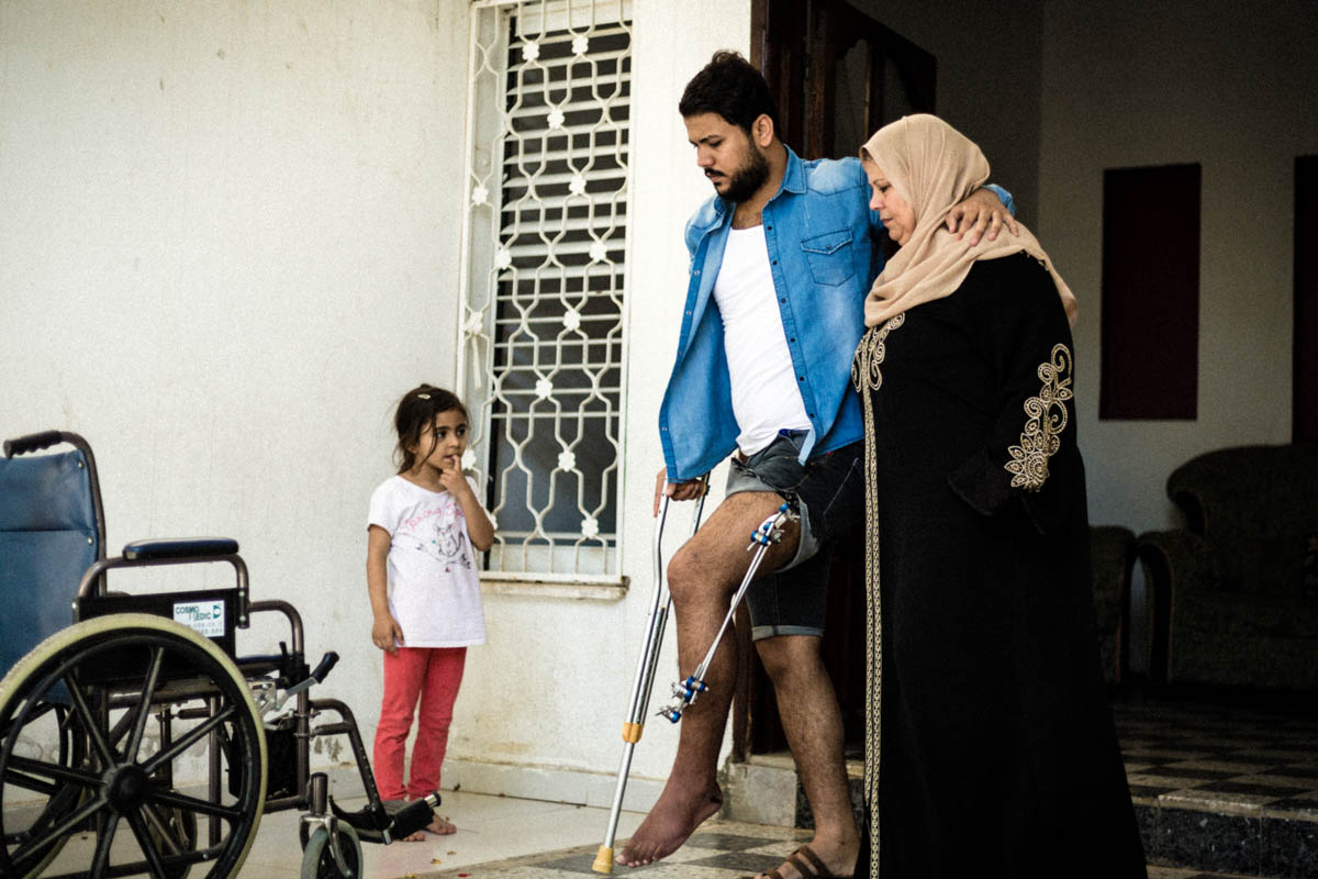 Since Mahmoud was injured in the border area and released from hospital, his family cares for him at home. 'We try to help him the best we can,' Mahmoud's mother said, 'but everybody is confused and we don't always know what to do.' [Alyona Synenko/ICRC]
