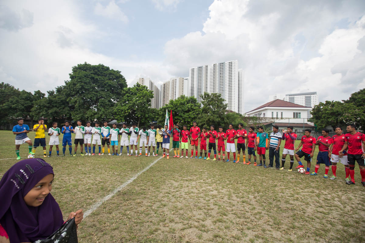 The two teams, RFC and RFM, line up for the friendly football match which took place in Kuala Lumpur. [Alexandra Radu/Al Jazeera]
