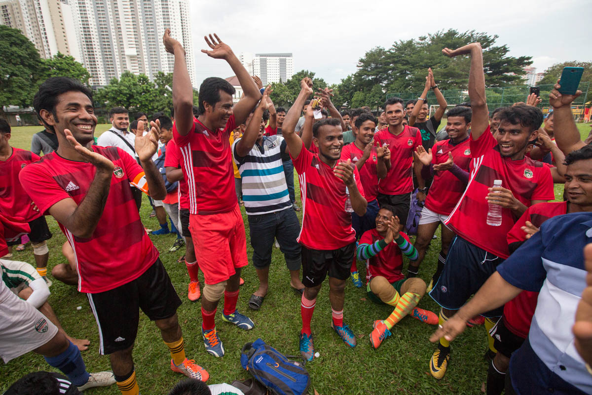 RFM players celebrate after the match. The Rohingya players in Malaysia dream to have the opportunity to play at an international level and represent their nation. [Alexandra Radu/Al Jazeera]