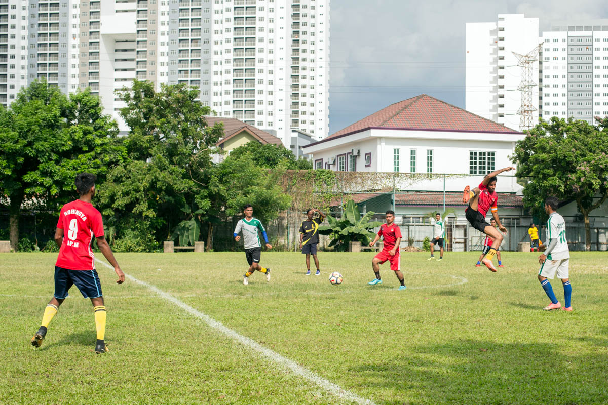 RFM team on the attack against RFC during the football friendly on a sunny day in Kuala Lumpur. [Alexandra Radu/Al Jazeera]