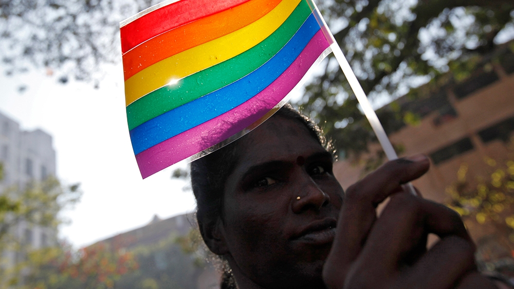 A participant holds a rainbow flag during Queer Azadi Mumbai 2011 (Queer  Freedom Mumbai 2011), a parade for gay and lesbian rights, in Mumbai on  January 29, ...