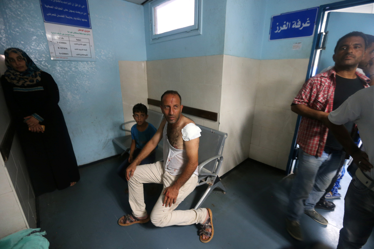 At least 30 people were wounded by the Israeli aerial bombardment. [Ibraheem Abu Mustafa/Reuters]