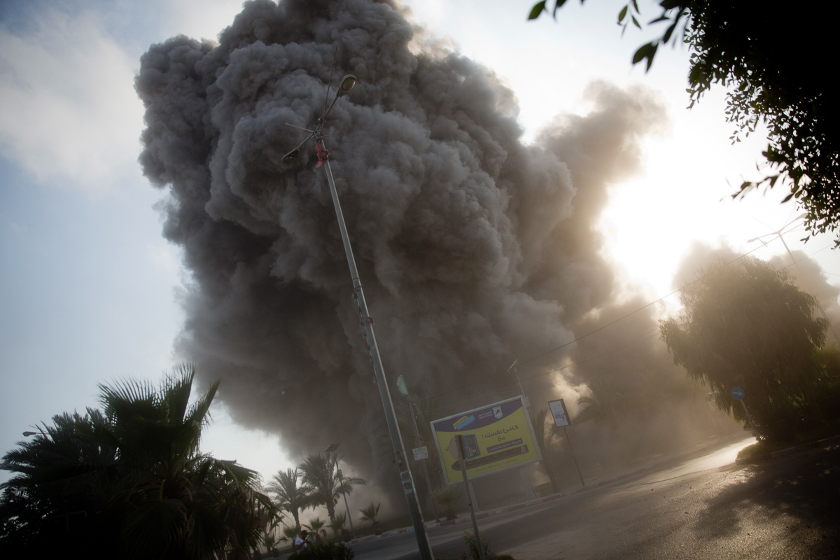 Smoke rises following an Israeli air attack in Gaza City on July 14, 2018. The Israeli military carried out its largest daytime air raid campaign in Gaza since the 2014 war. [Khalil Hamra/AP Photo]