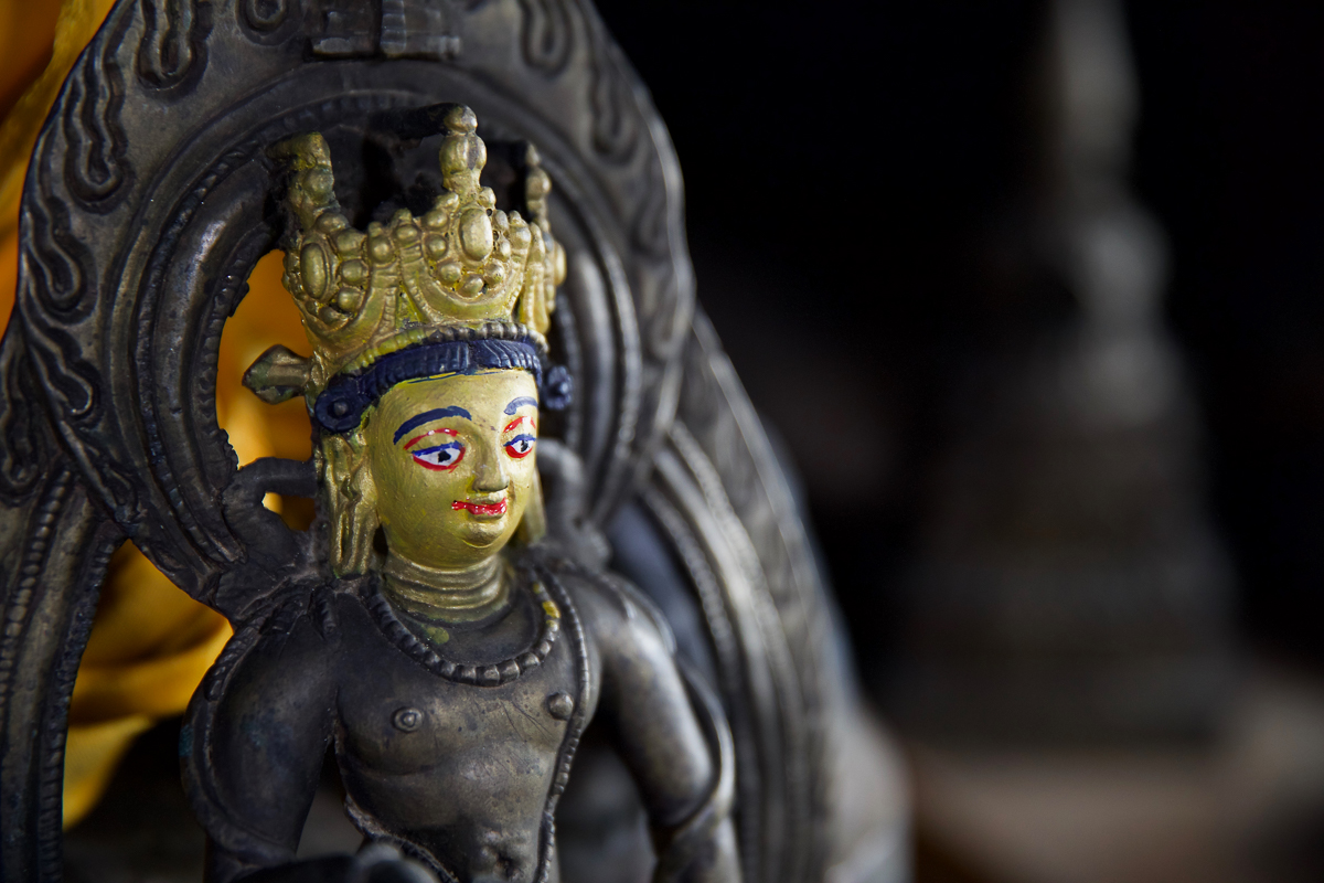 In a bid to deter thieves, monks in Nepal's Namgyal Monastery paint over the faces of their gods. Copper and bronze statues are highly sought after by international collectors, who at times employ thieves to steal them from religious places of worship. [Steve Chao/Al Jazeera]
