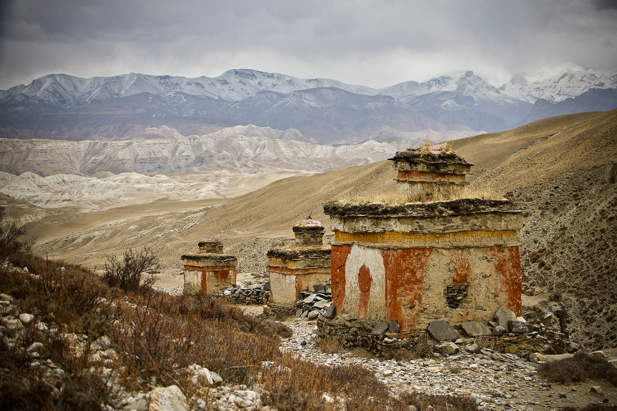 Rocks cover holes in the walls of ancient stupas in Samdaling, Nepal. Thieves broke through the walls to steal valuable Buddhist artefacts put there by Buddhist worshippers. On the international black market, these artefacts can be sold for hundreds of thousands of dollars. [Steve Chao/Al Jazeera]