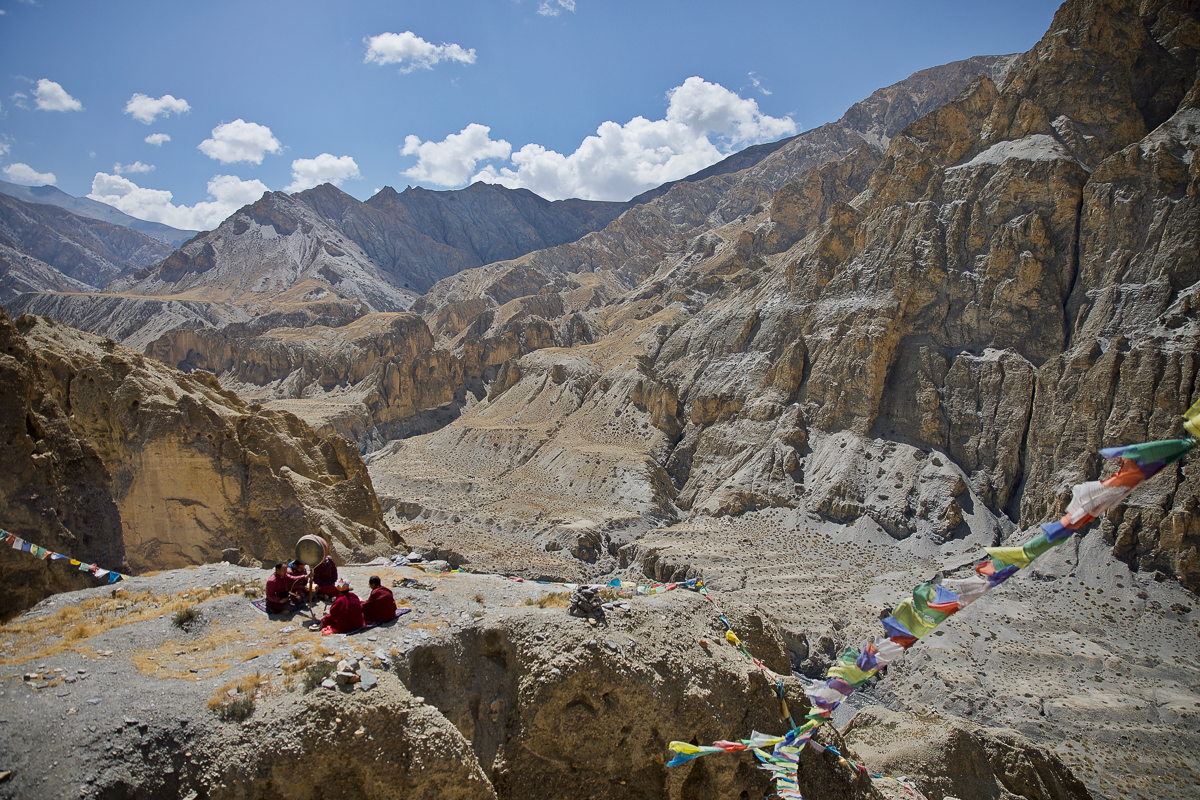 Buddhist monks worship on a hilltop in Mustang, Nepal. With a rising number of thefts at monasteries in this remote region, monks are praying for greater protection of their gods. [Steve Chao/Al Jazeera]
