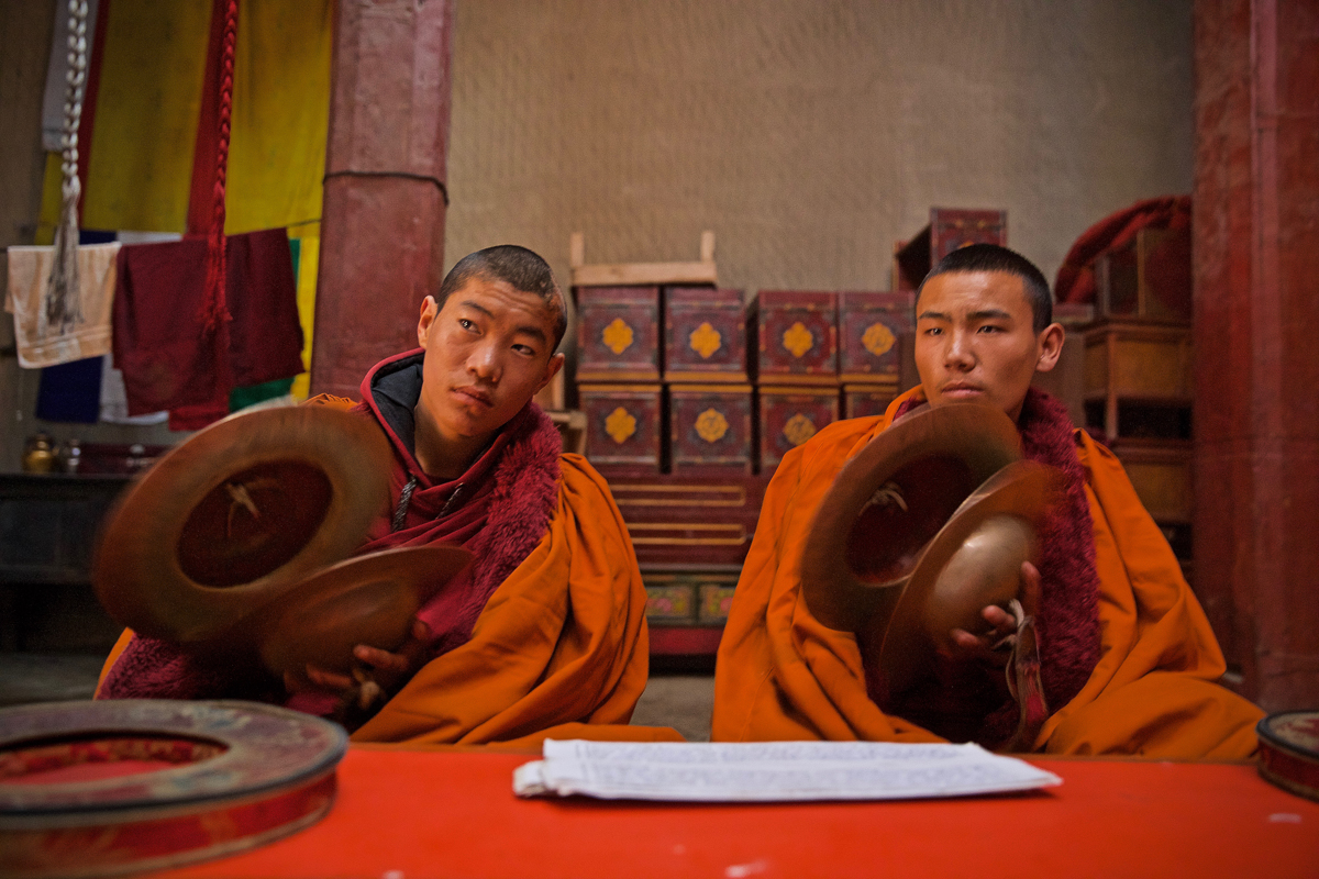 Young monks try to follow along during a worship practice in Lo Manthang, Mustang. As more idols are stolen from religious sites, many fear that Buddhism and a traditional way of life in these remote Himalayan regions is under threat – especially for a young generation that is growing up without many of the idols that their ancestors worshipped. [Steve Chao/Al Jazeera]