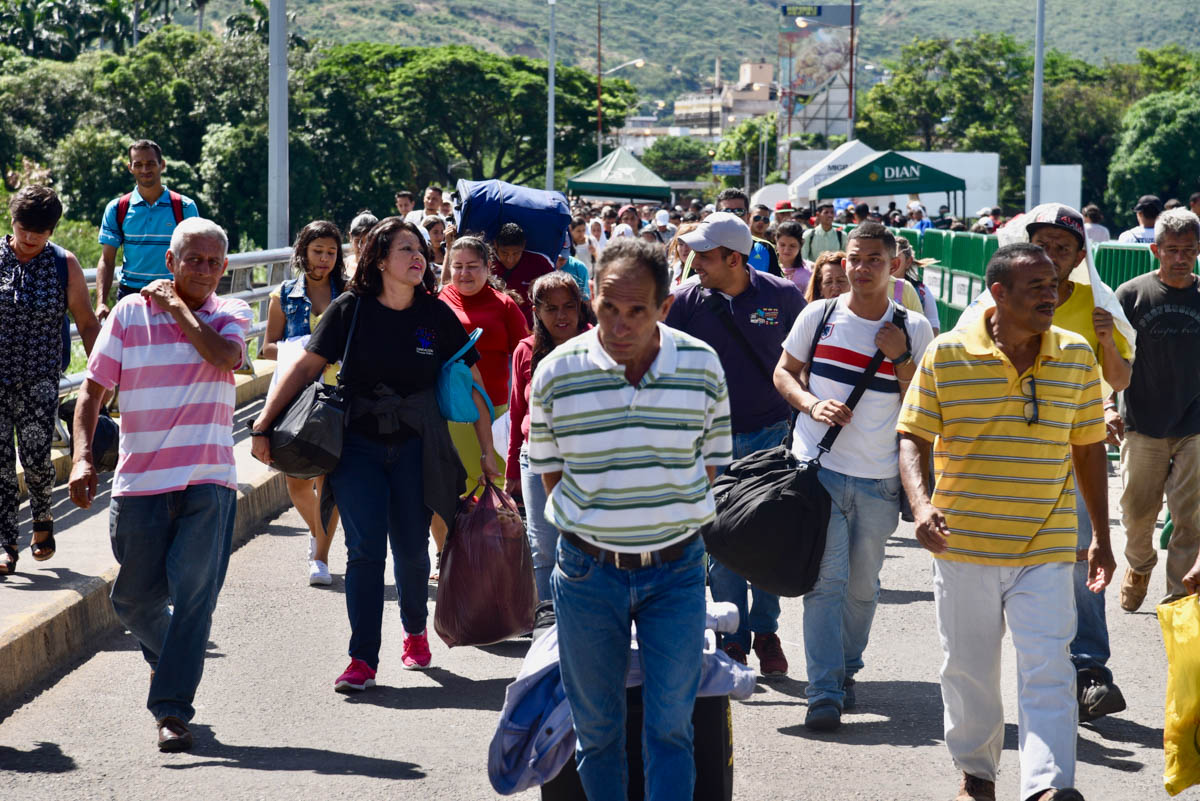 More than 35,000 people cross the bridge from Venezuela into Colombia every day. Many return daily, but around 4,000 people stay in the border city, Cucuta, or move further into Colombia or to neighbouring countries. People sell and buy items at the market near the bridge so they can take money and goods to their families in Venezuela. Simon Bolivar Bridge, Colombia. [Iris V. Ebert/IRC]