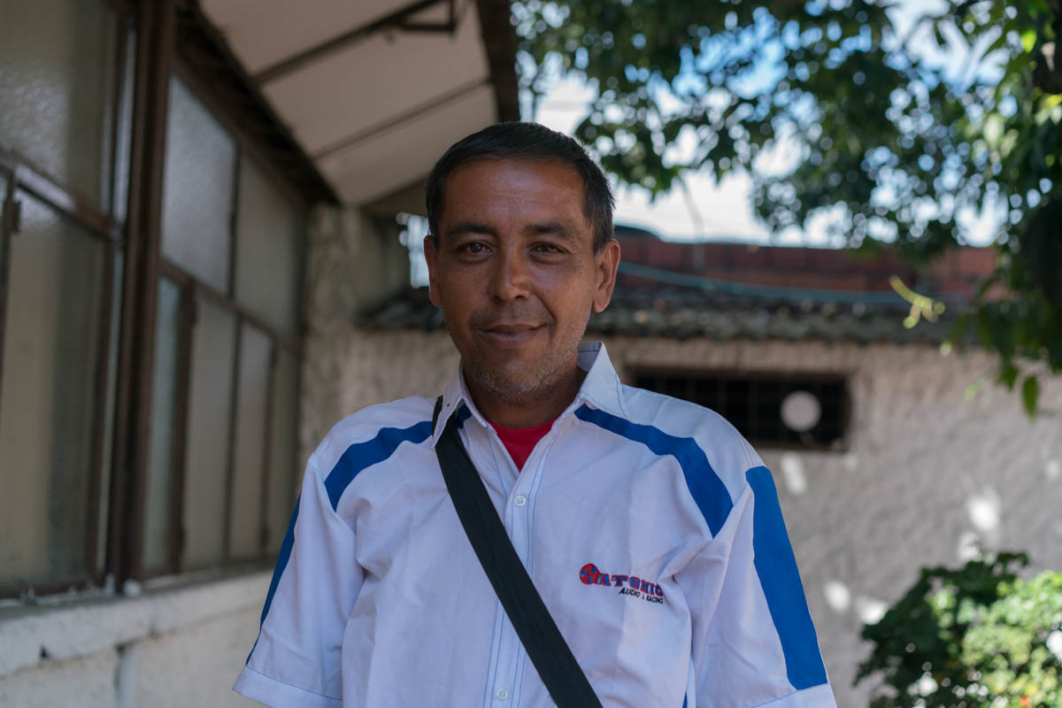 "Carlos* was a science professor and a lawyer for over 15 years, he lost both jobs with the economic crisis in Venezuela. ""I've lost 22 kilos in the past year, imagine my children. I'm living on the streets, I can't bear to bring my wife and children here,"" he said. The few possessions he has from Venezuela are a black bag, a bible, a book called ""What does the bible teach us?"", and a pamphlet that reads, ""The bible and its message."" [Iris V. Ebert/IRC]"