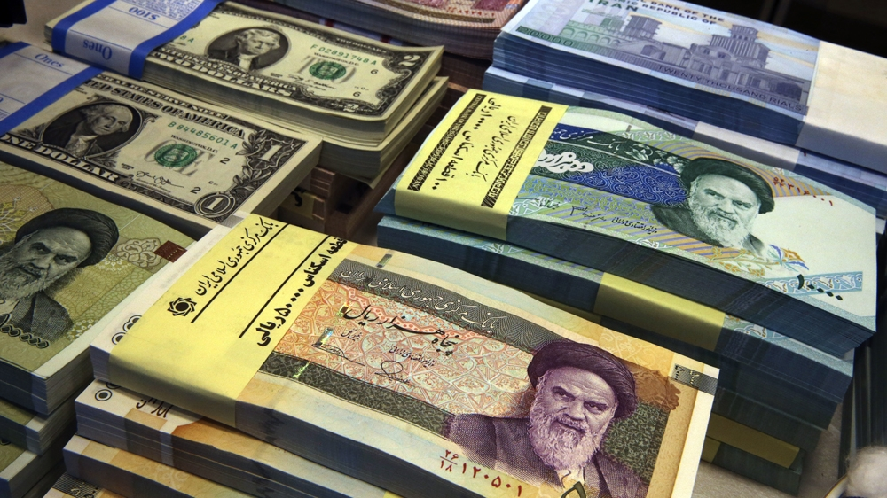 Iran S Currency Plunges To Record Low