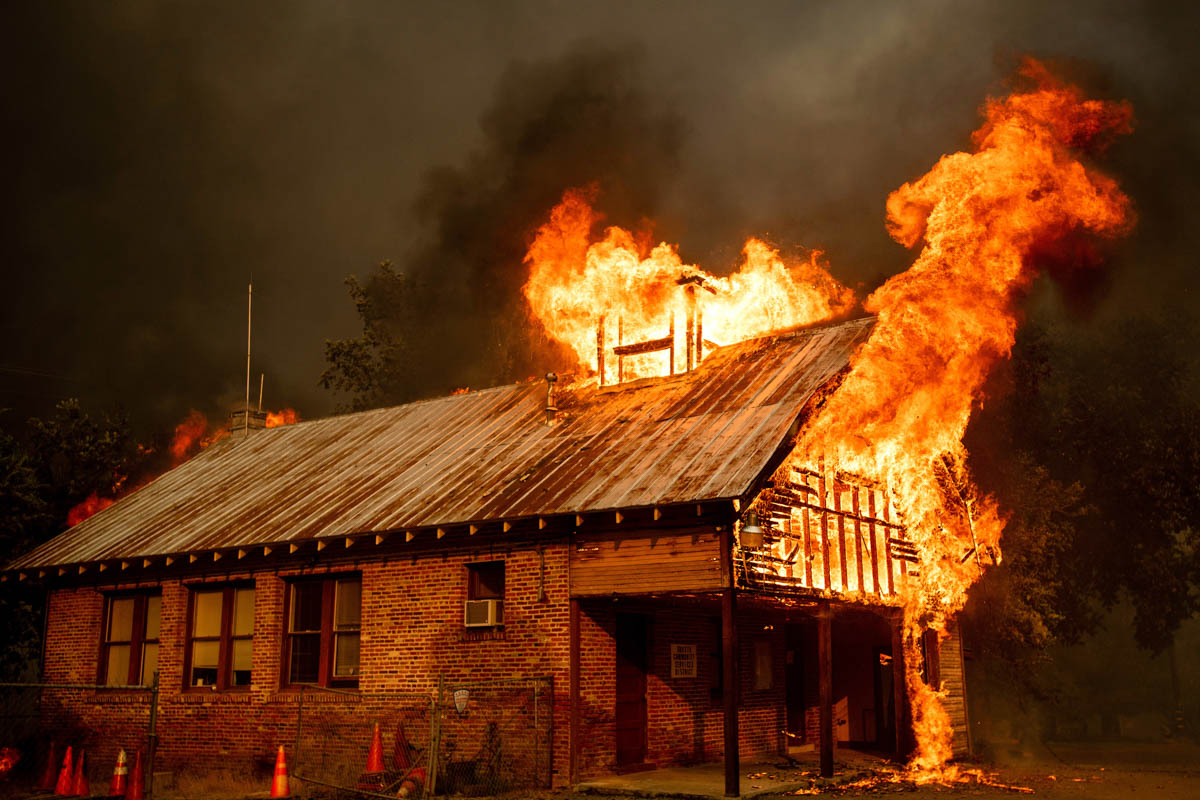 An historic schoolhouse burns as the Carr Fire tears through Shasta, California. Fueled by high temperatures, wind and low humidity, the blaze destroyed multiple homes and at least one historic building. [Noah Berger/AP Photo]