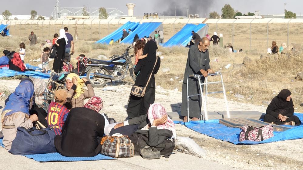 Alcuni degli sfollati di Deraa lungo il confine giordano. Credits to: Ammar Al Ali/Anadolu.