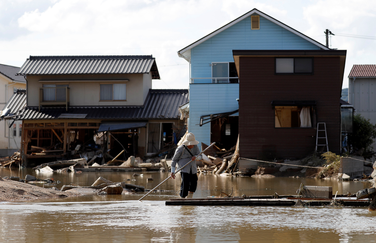 The government has set aside 70bn yen ($631m) in infrastructure funds to respond to disasters, with 350bn yen ($3.15bn) in reserve, Taro Aso, the finance minister, said. [Issei Kato/Reuters]
