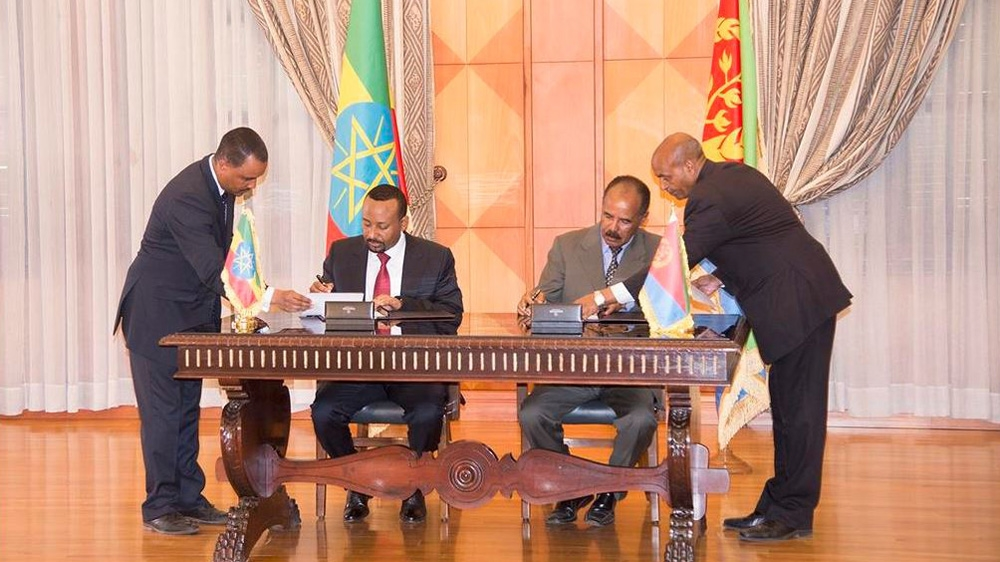Abiy signed an agreement with Eritrean President Isaias Afkwerki on Monday [Al Jazeera
