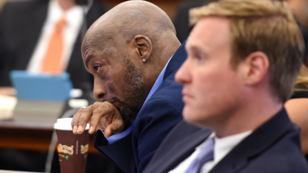 Plaintiff Dewayne Johnson reacts while his attorney during the Monsanto trial