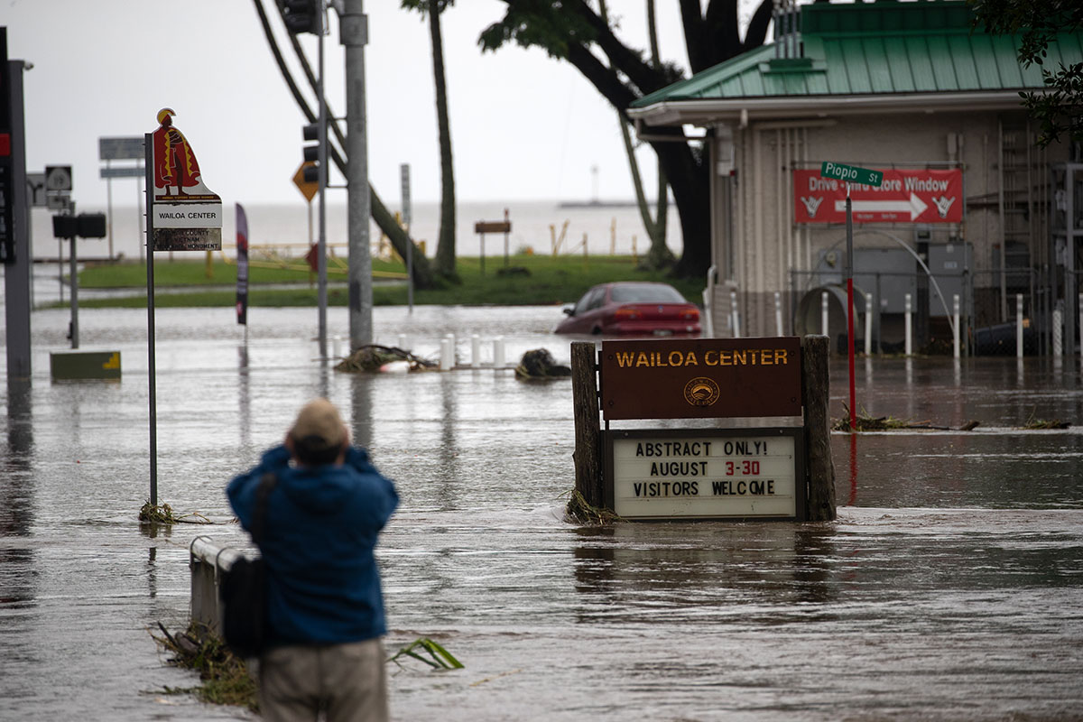 In a rare event, powerful Hurricane Lane, once a category-5 storm, brought extensive flooding to Hawaii's Big Island. [Bruce Omori/EPA]