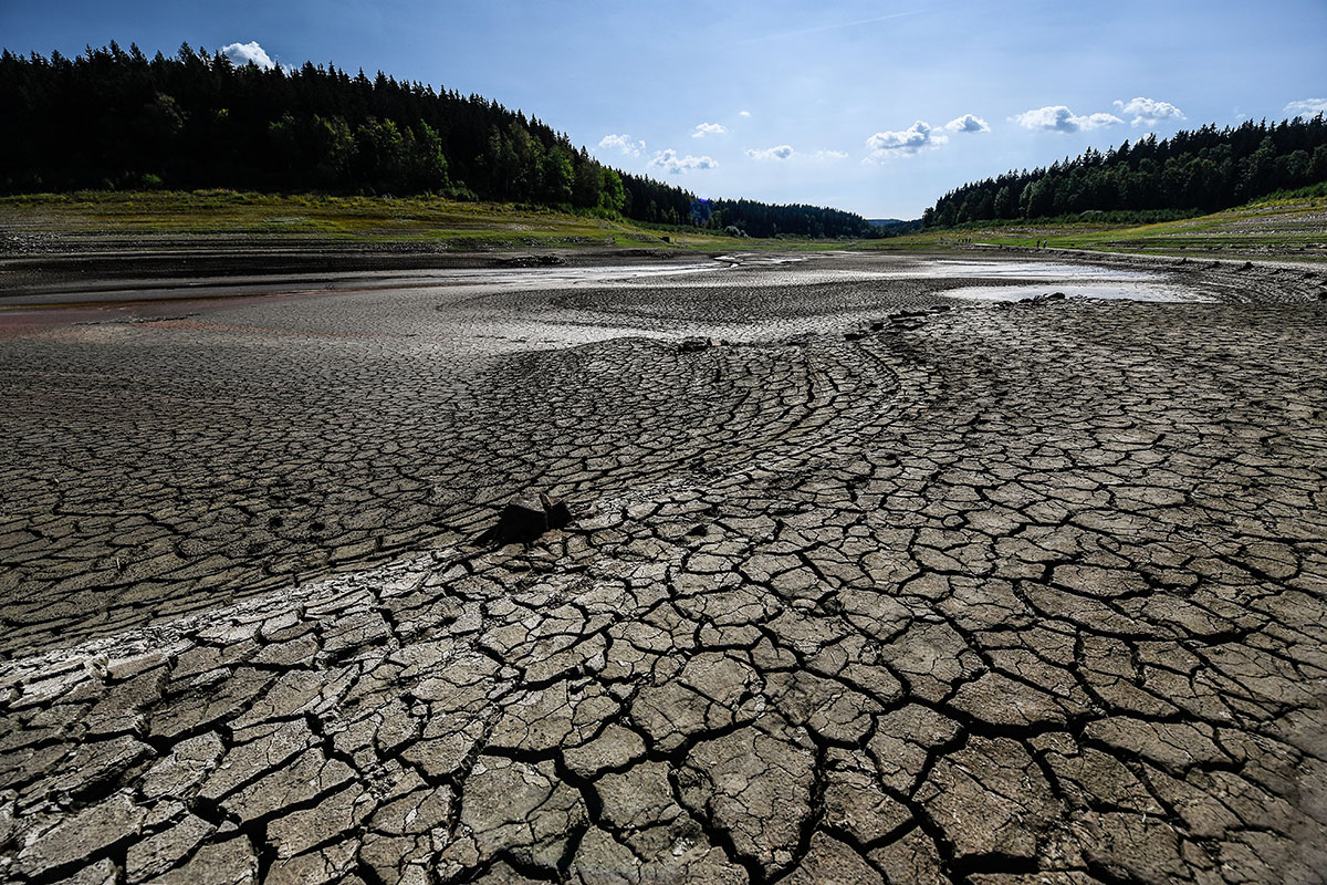 A dried out reservoir in Germany is one of many signs of the ongoing drought that are everywhere in Central and Northern Europe. [Filip Singer/EPA]