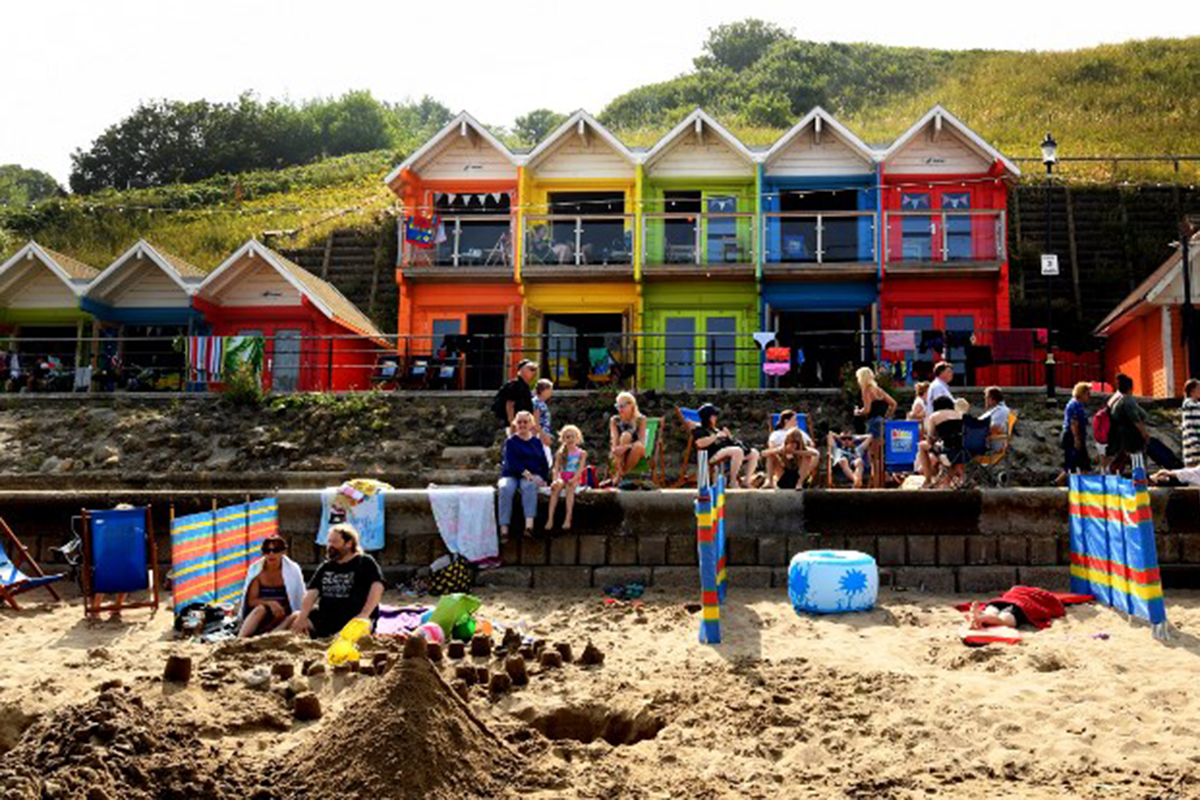 The holiday sector has boomed in many parts of Europe with long, hot days encouraging thousands to head for the coasts, including Scarborough, UK. [Paul Ellis/AFP]