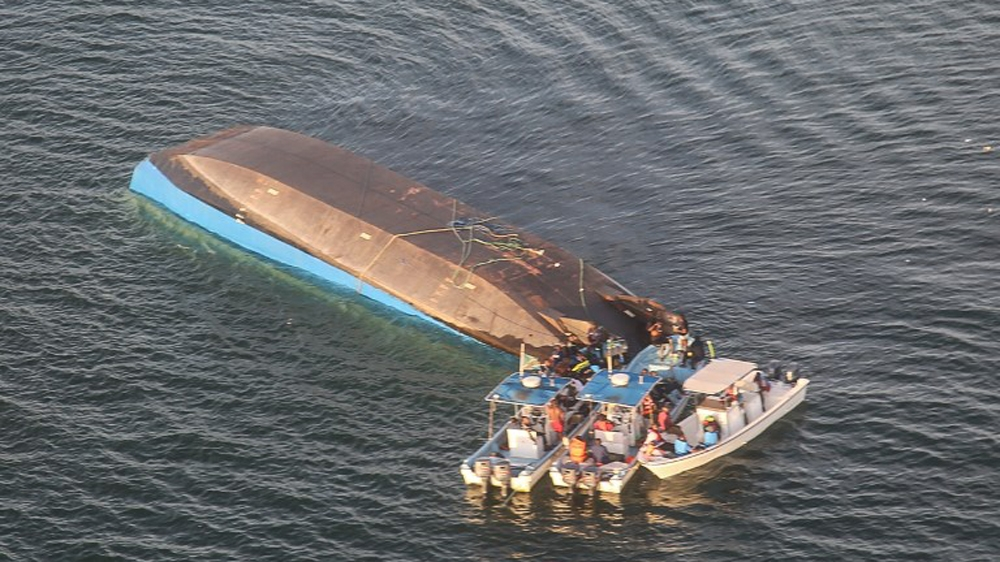 Tanzania ferry disaster: divers pull survivor from capsized ship