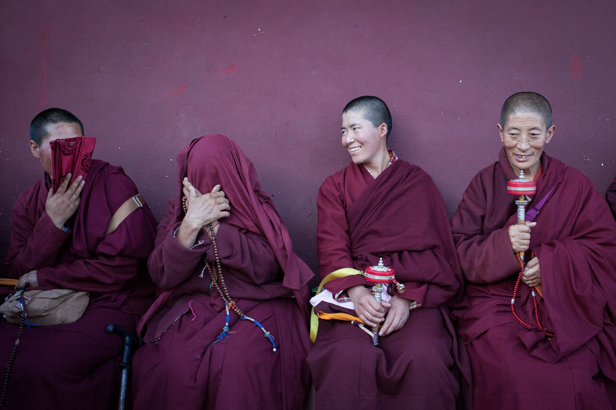 A rest from the work and prayer; a group of nuns joke together. [Douglas Hook/Al Jazeera]