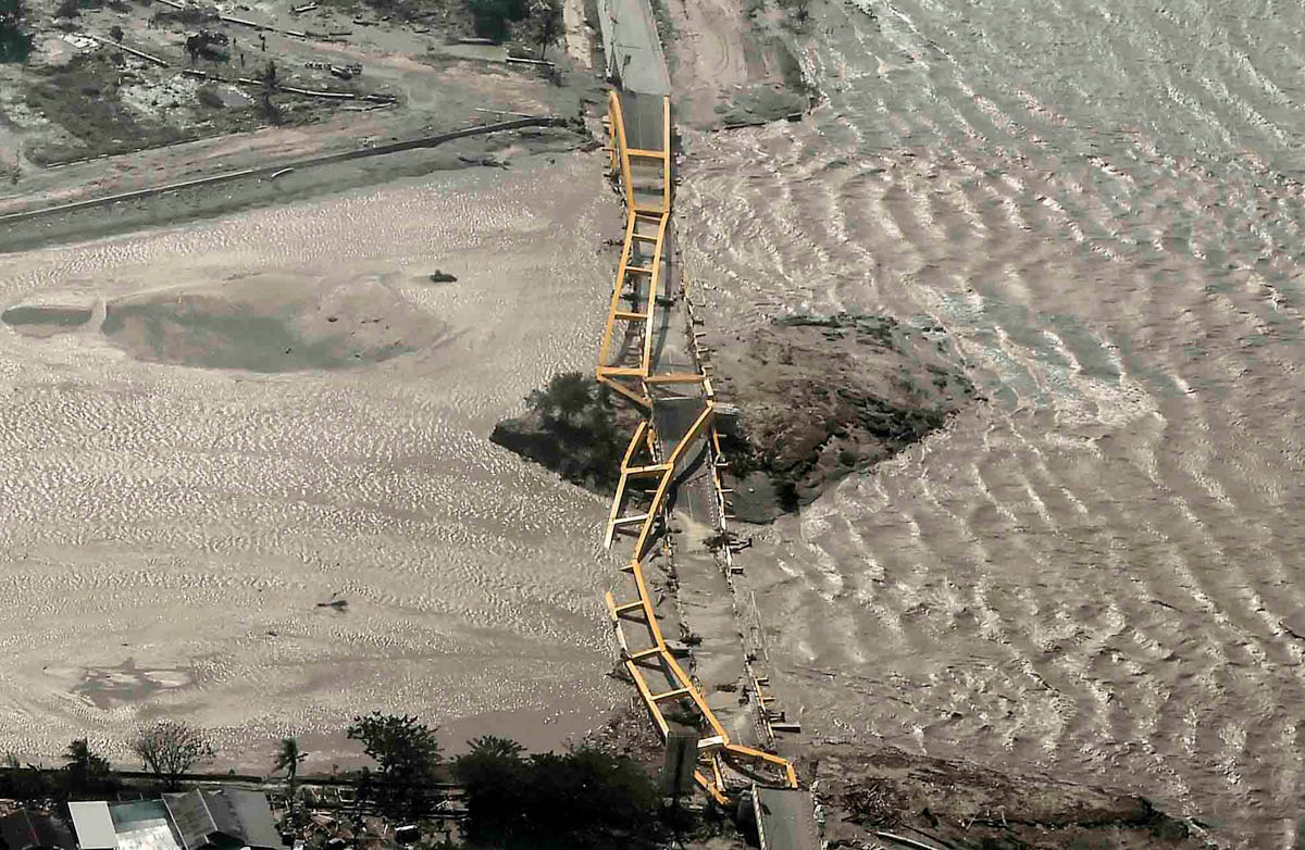 An aerial view shows a bridge damaged by the earthquake in Palu, Central Sulawesi, Indonesia. [Muhammad Adimaja/Antara Foto/Reuters]