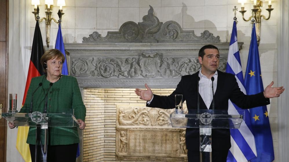 In Greece, Merkel embraces former Eurosceptics