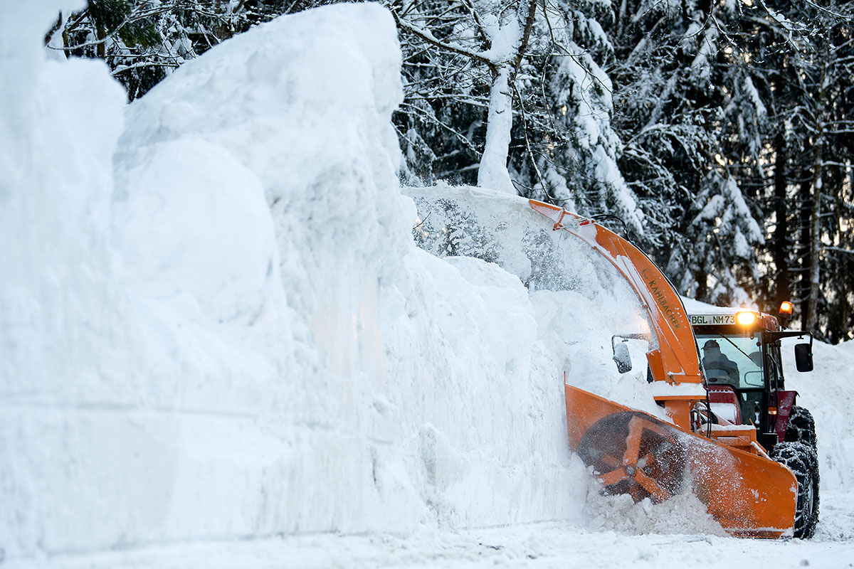 A snow blower clears a parking space in Schoenau am Koenigssee, Germany. [Matthias Hangst/Getty Images]