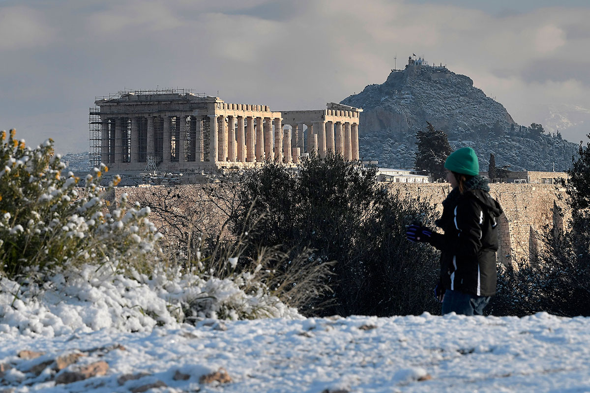 View of the ancient Acropolis Hill in Athens, Greece, after snow blanketed the Greek capital. [Milos Bicanski/Getty Images]