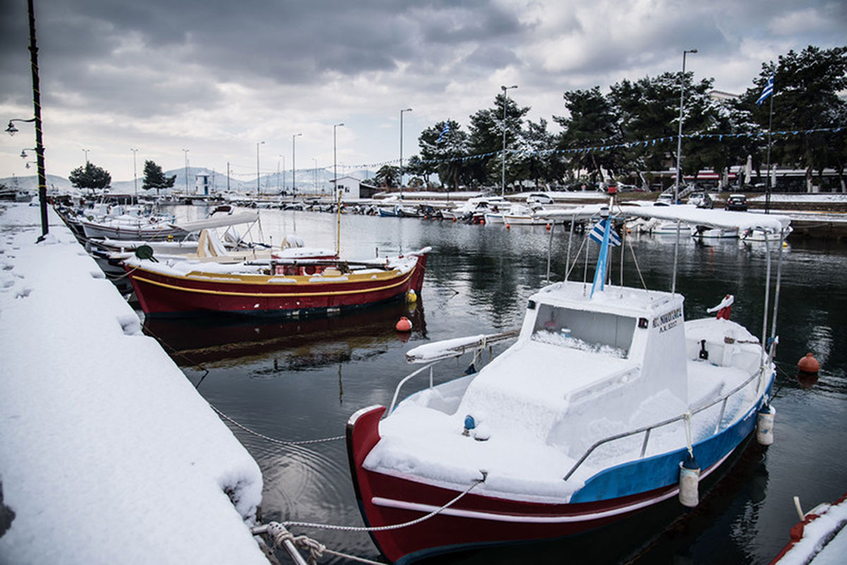 Snow covered boats in Euboea island, Greece. [Wassilis Aswestopoulos/EPA]