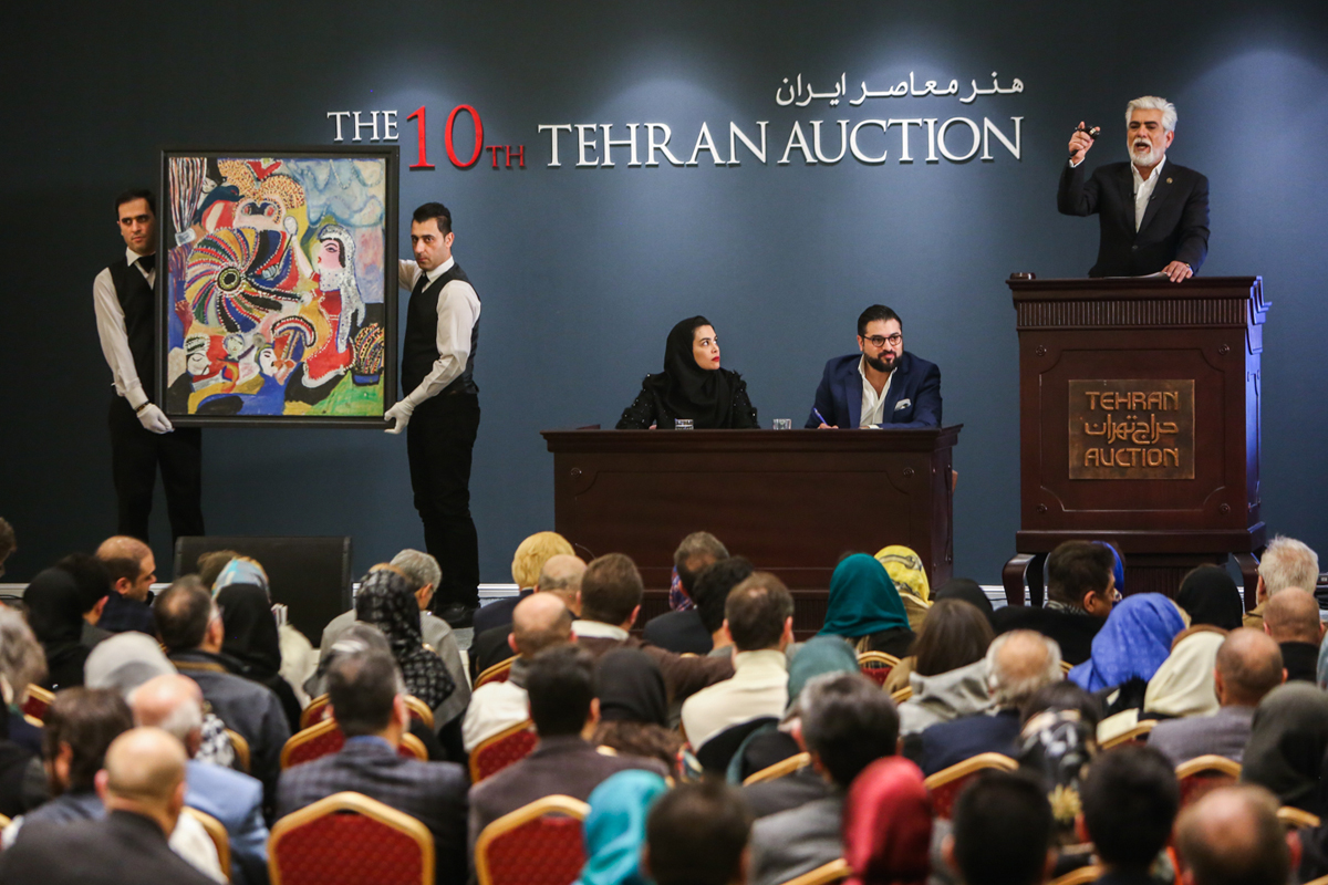 With the return of US sanctions and the plunge of the Iranian currency, expectations during the 10th Tehran Auction were not as high as in previous years. [Mohammad Ali Najib/Al Jazeera]