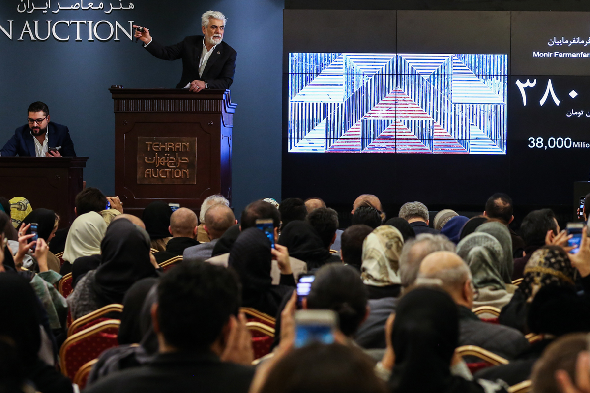 More than 1,000 people gathered at a hotel in northern Tehran on Friday to witness Monir Farmanfarmaian shatter another auction record for a female artist in Iran. [Mohammad Ali Najib/Al Jazeera]