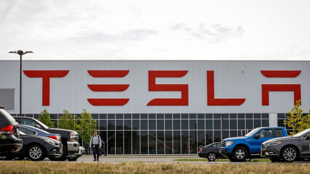 Tesla cuts thousands of jobs to face 'very difficult' road ahead