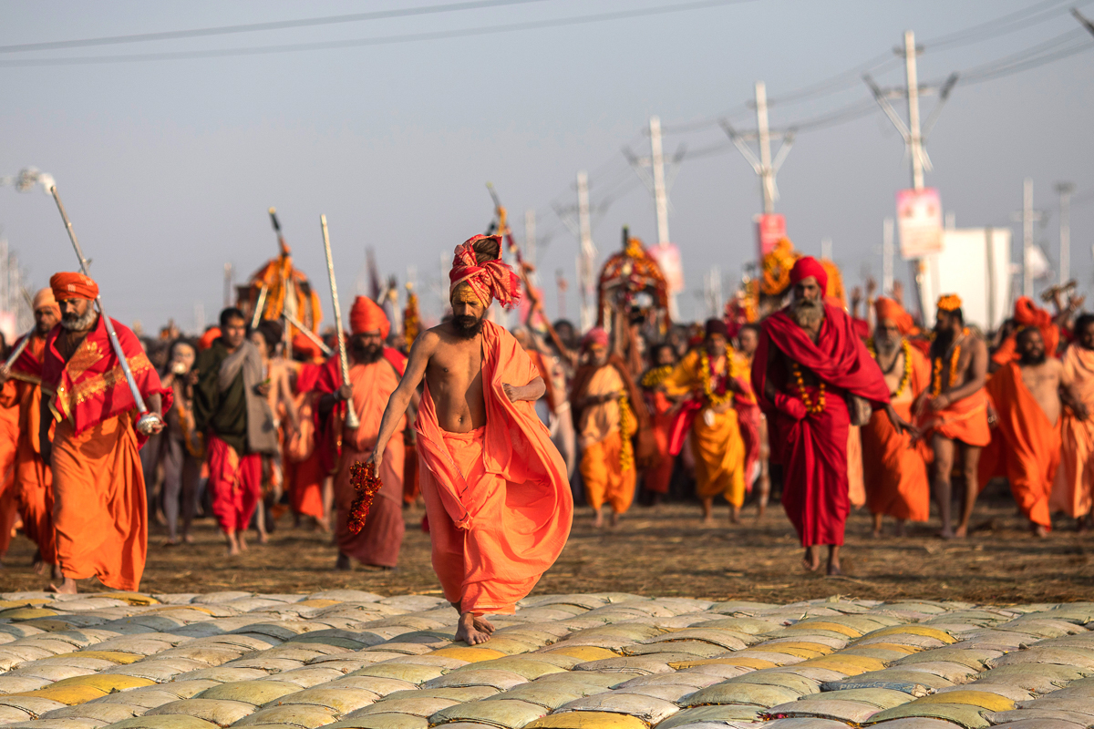 Hindu holy men arrive for a dip on the auspicious Makar Sankranti day during the Kumbh Mela. [Bernat Armangue/AP Photo]