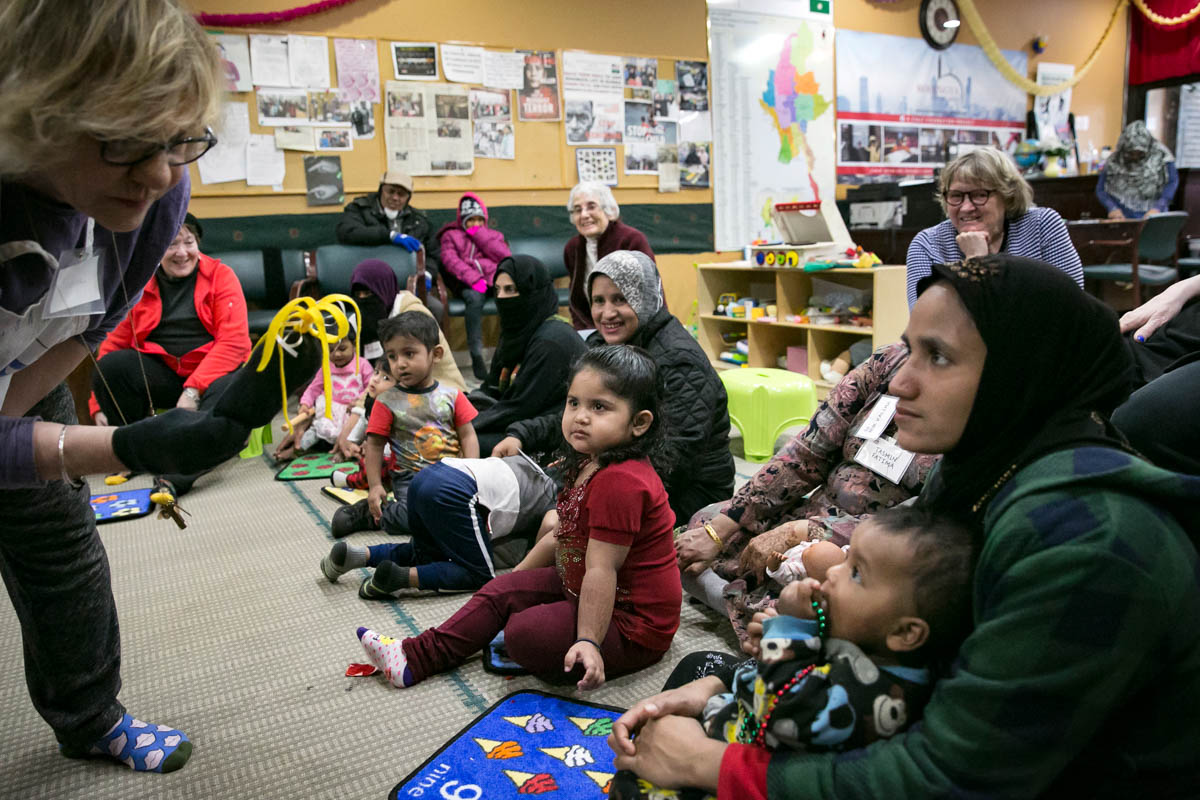 Rohingya mothers play with their children during a 'Mommy and Me' class at the Rohingya Cultural Center of Chicago. The class teaches children structured play, mothers how to bond with their children and prepare the children for school. [Allison Joyce/Getty Images]