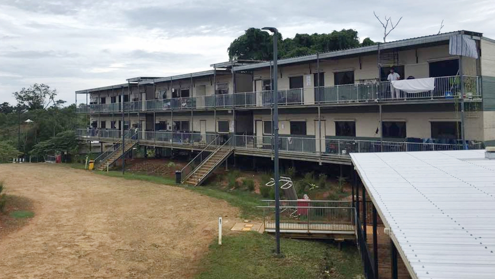 In this July 17, 2018, photo provided by Aziz Abdul, a man standing on a balcony at the East Lorengau Refugee Transit Center on Manus Island, Papua New Guinea.