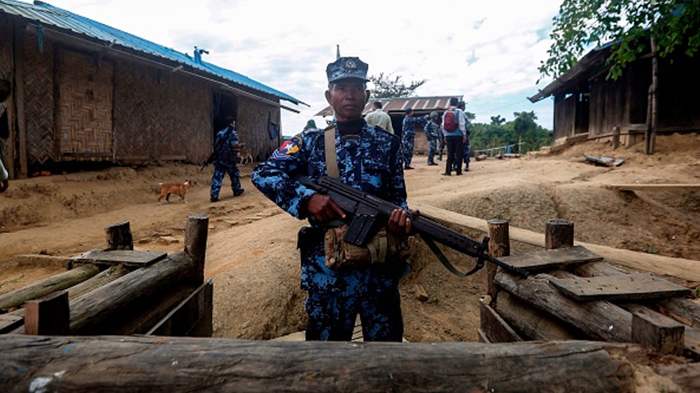"""MYANMAR CONFLICT SECURITY A police officer from the Myanmar Border Police gurgled a police station in Buthidaung on January 7, 2019. - Myanmar has called on its military to launch """"operations"""" against ethnic Rakhine"""