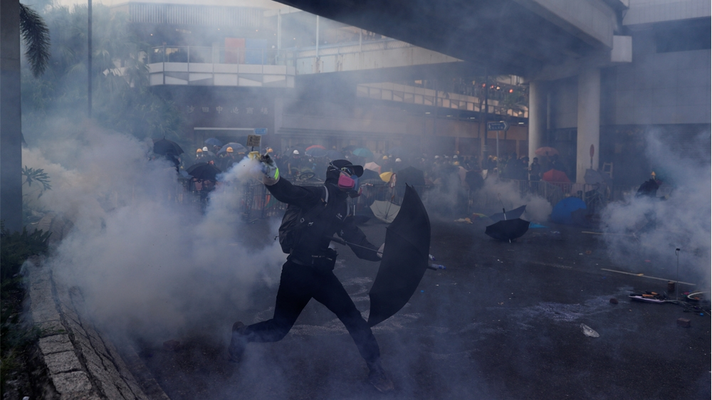 An anti-government protester throws a tear gas canister during a protest in Sha Tin district, on China's National Day in Hong Kong, China October 1, 2019. REUTERS/Jorge Silva