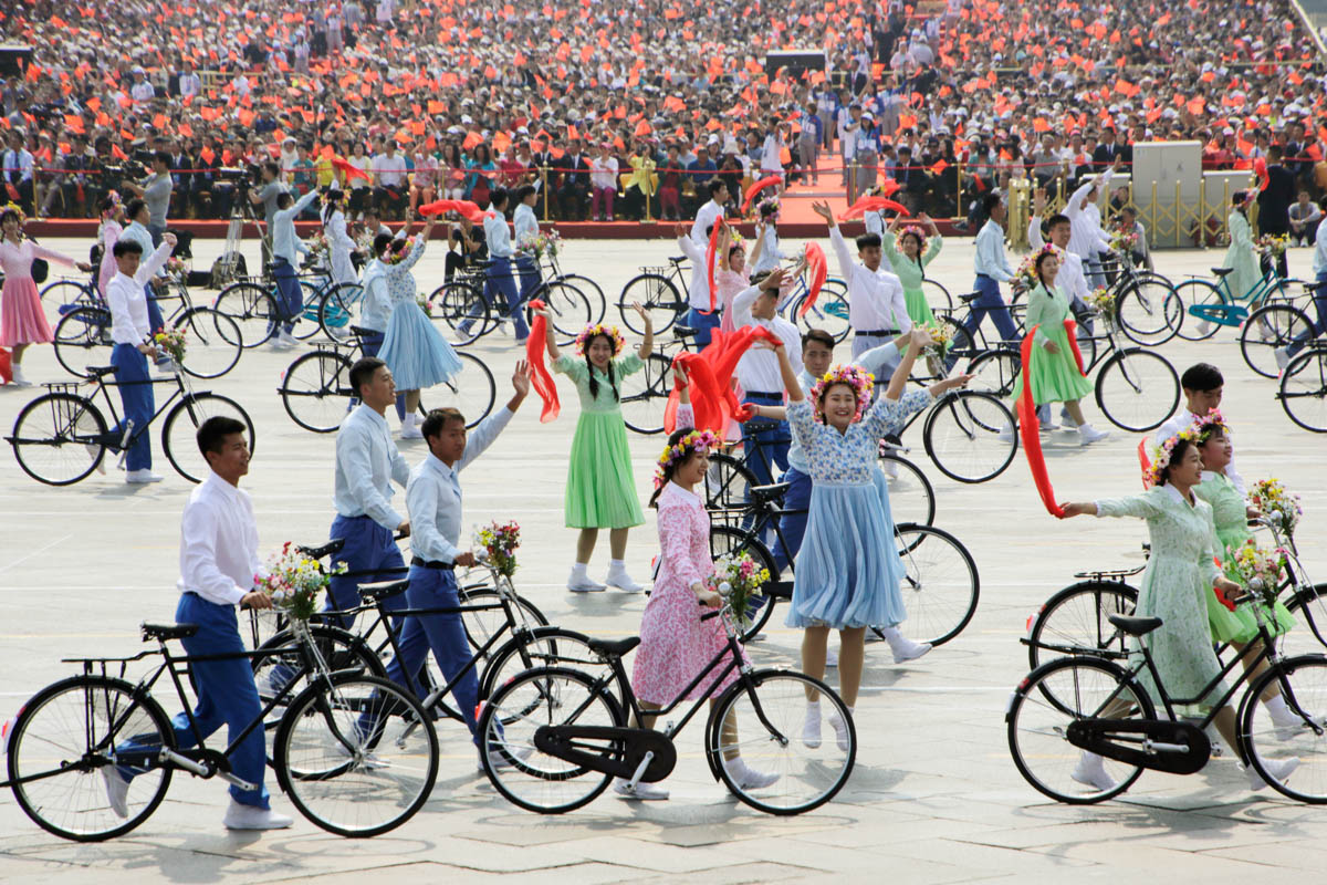 Performers with bicycles take part in the parade marking the 70th founding anniversary of the People's Republic of China on its National Day in Beijing. [Jason Lee/Reuters]