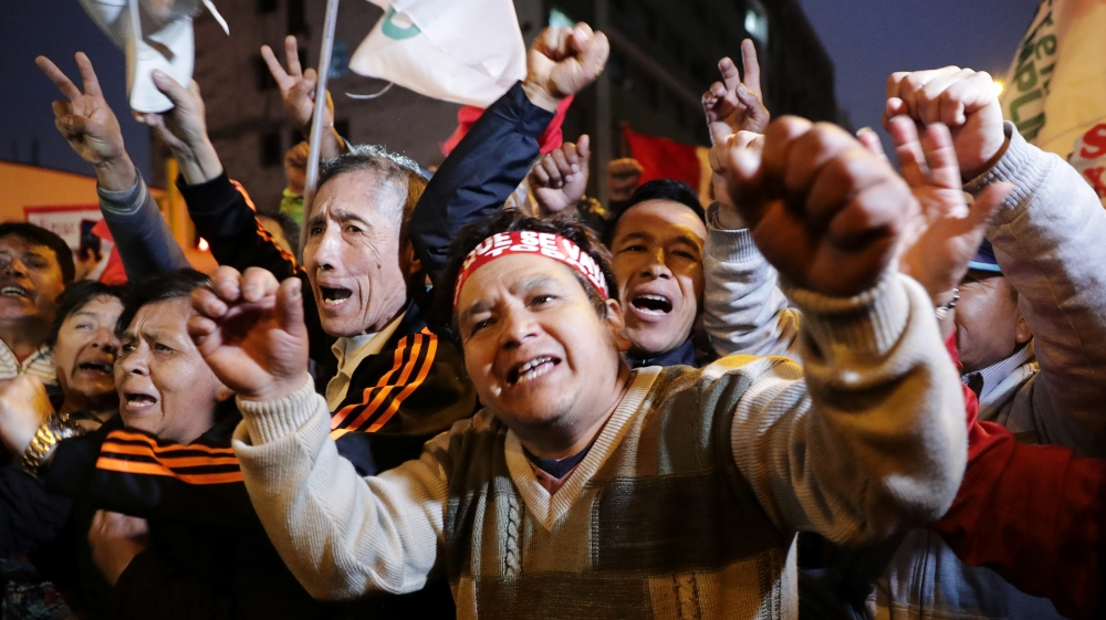 Supporters of Peru's President Martin Vizcarra celebrate outside the Congress building after the president shut down Congress in Lima